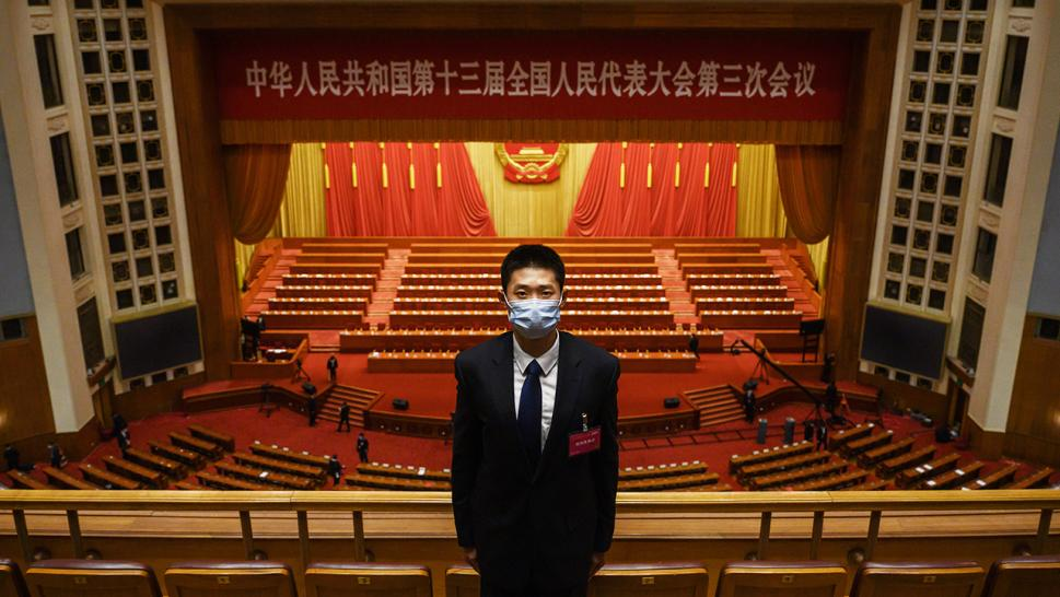 A security officer guards the closing session of the National People's Congress, at which the Chinese government passed a draft of a national security law for Hong Kong.
