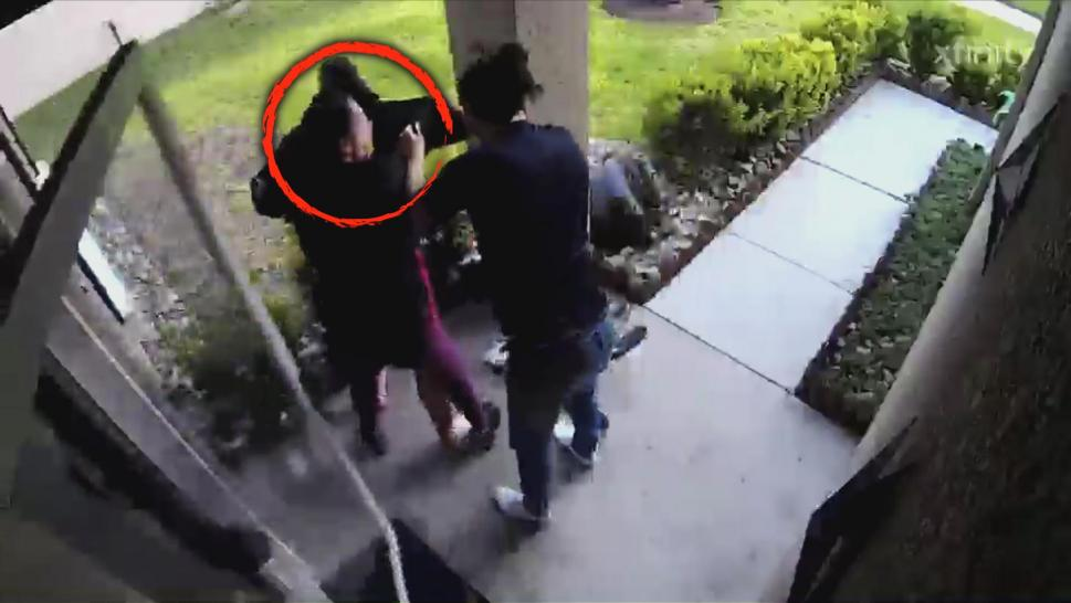 Woman rescuing her choking neighbor