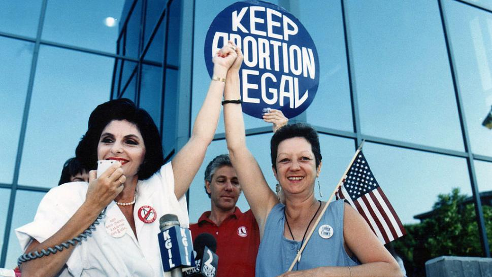 Norma McCorvey with attorney Gloria Allred in 1989