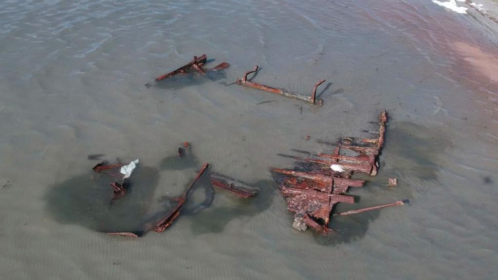 A storm uncovered a ship believed to have sunk in the early 1900s.