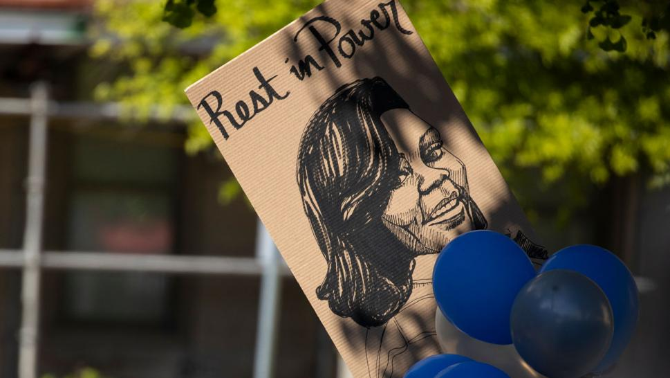 An image of Breonna Taylor is displayed a vigle for the slain EMT.