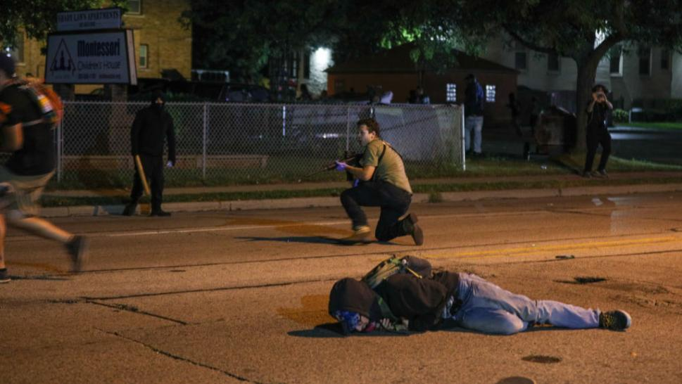 A gunman is shown in Kenosha, Wisconsin, during protests against the police shooting of Jacob Blake.