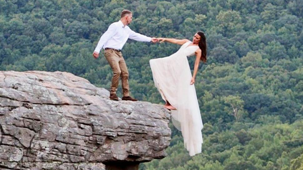 Newlyweds Dangle From Cliff for Wedding Photo