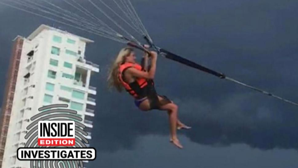 Woman parasailing in stormy weather