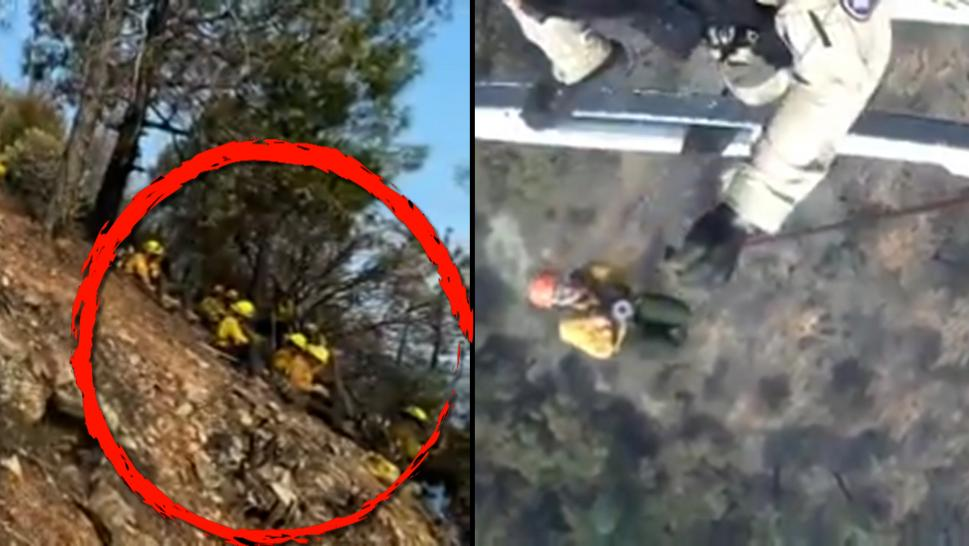 Firefighters being rescued