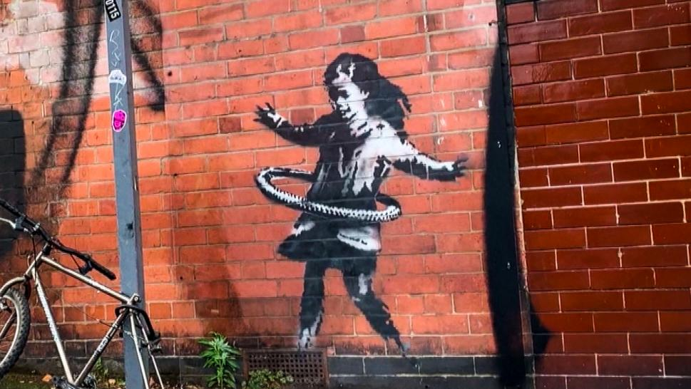 New Banksy Mural Shows Girl Using Bike Tire as Hula Hoop