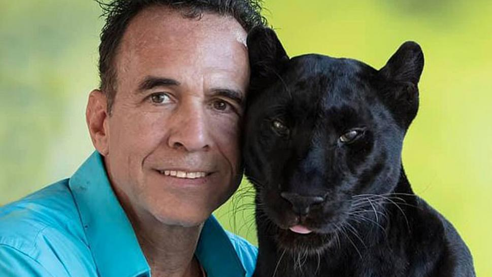 Michael Poggi pictured with his black leopard