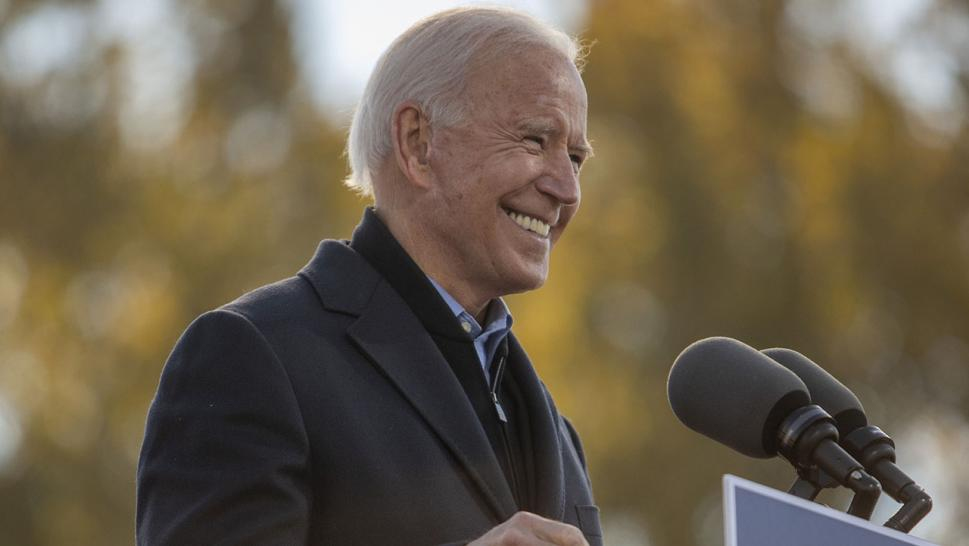 Joe Biden, 2020 Democratic presidential nominee, smiles while speaking during a drive-in rally at the Iowa State Fairgrounds in Des Moines, Iowa, U.S., on Friday, Oct. 30, 2020.