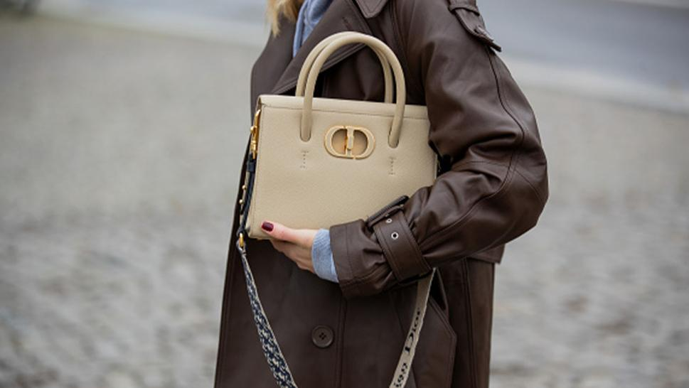 Image of a woman holding a handbag