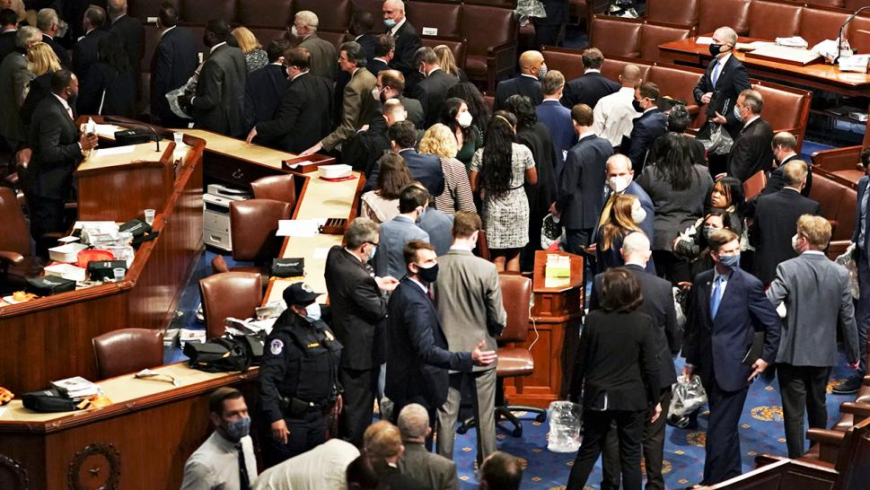 Some members of Congress could be seen not wearing masks as they were instructed to evacuate during last Wednesday's insurrection.
