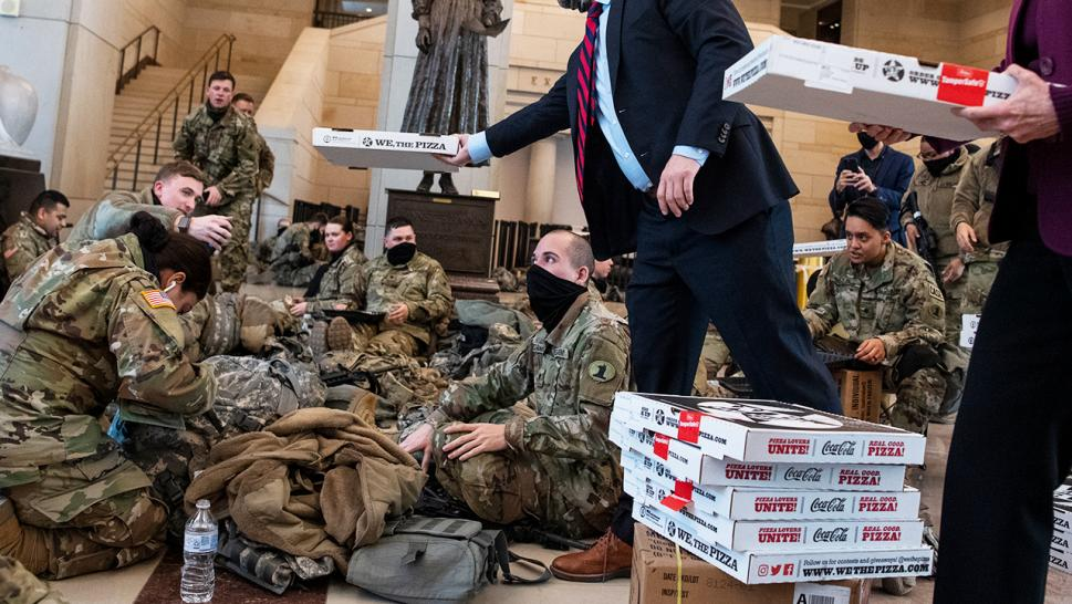 Members of the National Guard are enjoying pies delivered by local pizzeria, We, The Pizza.