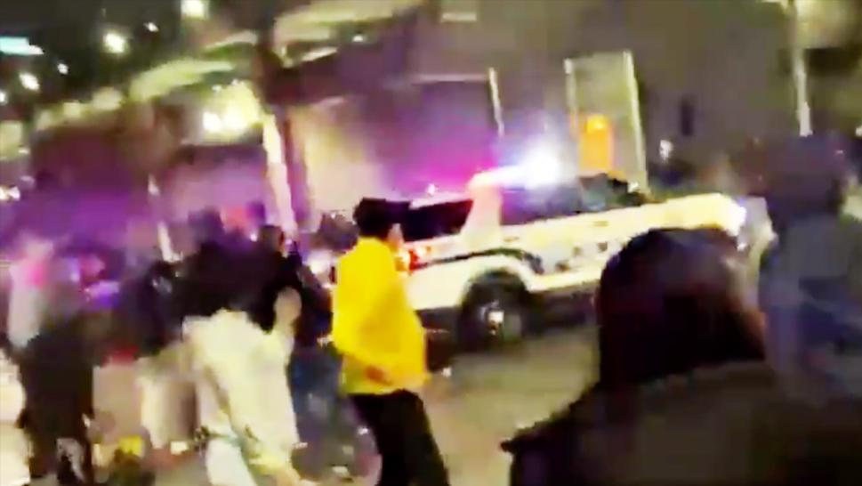 Viral video showed a police cruiser driving into a crowd Saturday night.