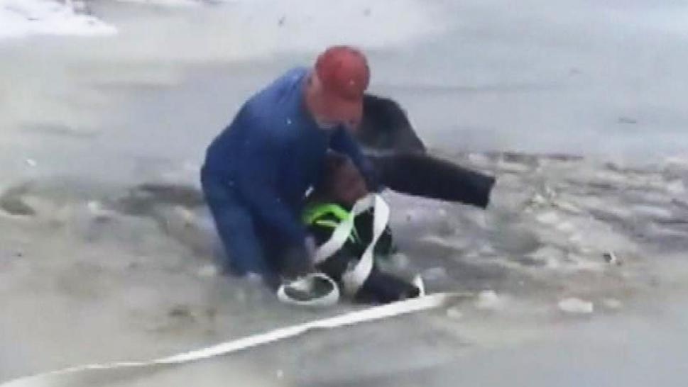Randy Thomas rescuing an 11-year-old boy from a frozen pond