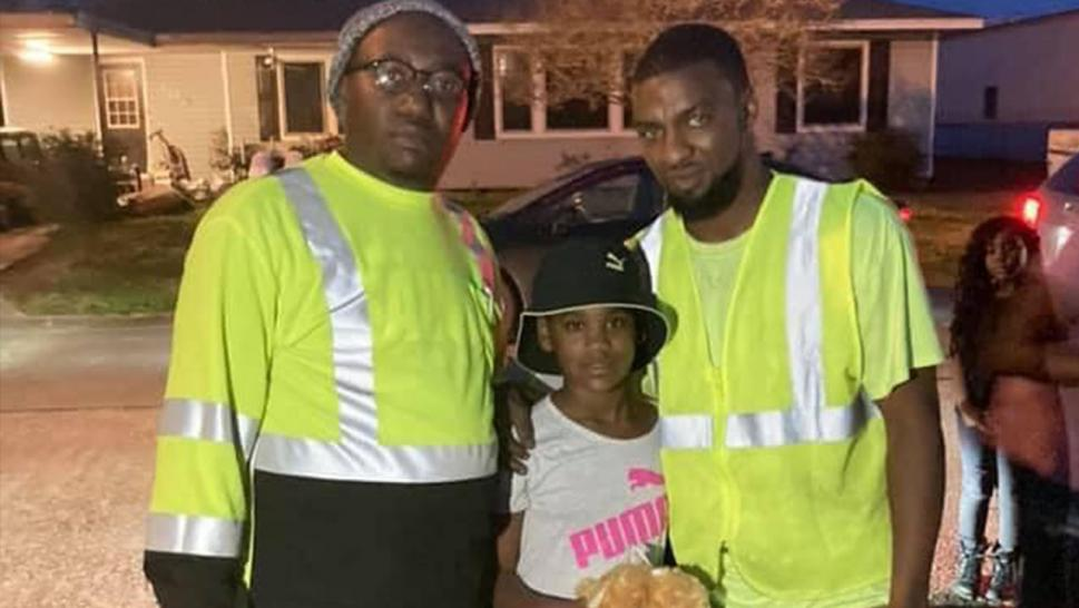 L-R: Heroes: Dion Merrick and Brandon Antoine with 10 yr. old, Jalisa Lasalle