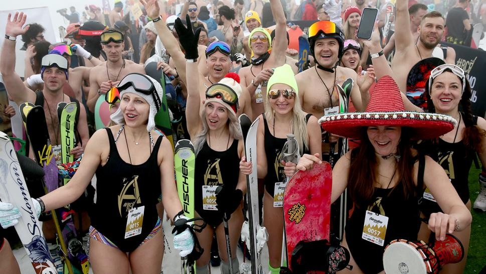 Snowboarders and skiers pose for a photograph during the BoogelWoogel mountain carnival at the Rosa Khutor resort.