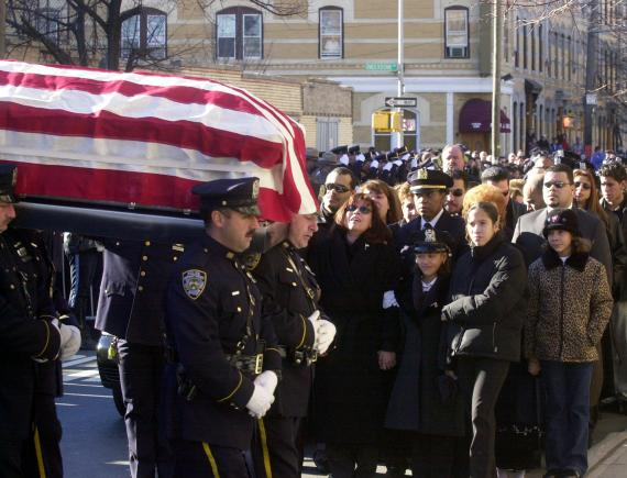Photos depicting the funeral for the father of three, who was posthumously awarded the department's highest honor, the Medal of Honor, showed his daughter Jillian wearing an eight-point police cap.