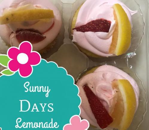 Lemonade cupcakes topped with strawberry slices.