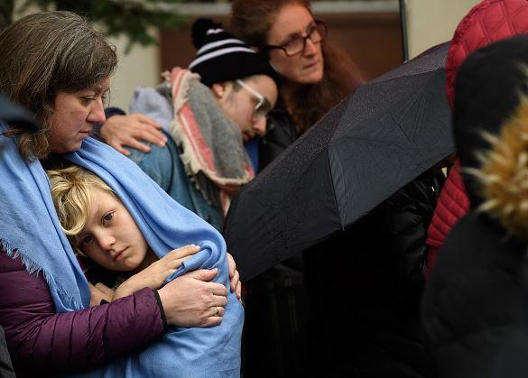 Mourners gather outside Pittsburgh synagogue where an anti-Semitic gunman opened fire.