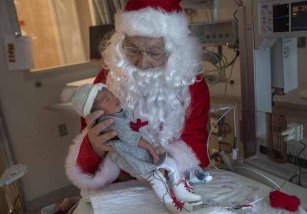 Santa Claus meets with a preemie that donned ice skates.