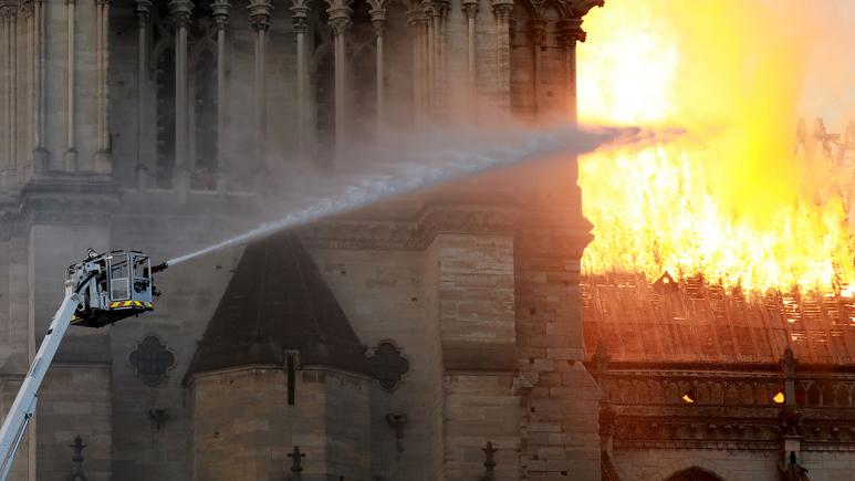 A firefighter battles the Notre Dame blaze.