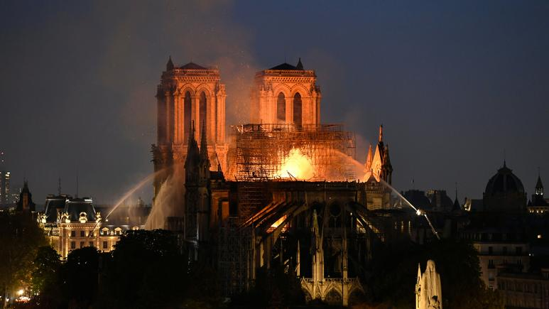 The Notre Dame blaze continues to rage at night.