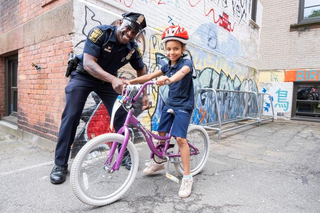 With Pedal Thru Youth, police officers give kids their first bikes and teach them safety rules.