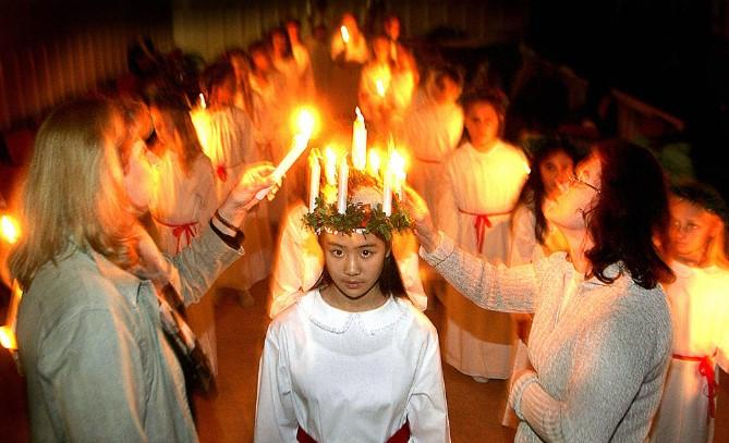 Residents in Stockholm celebrate St. Lucia festival during winter solstice.