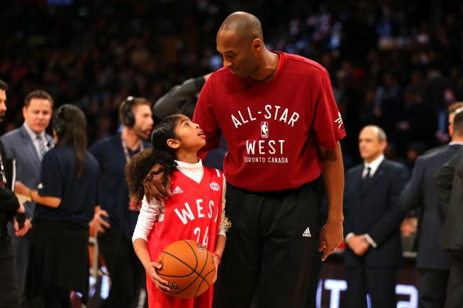 Gianna Bryant holds a basketball next to her dad Kobe during warm up