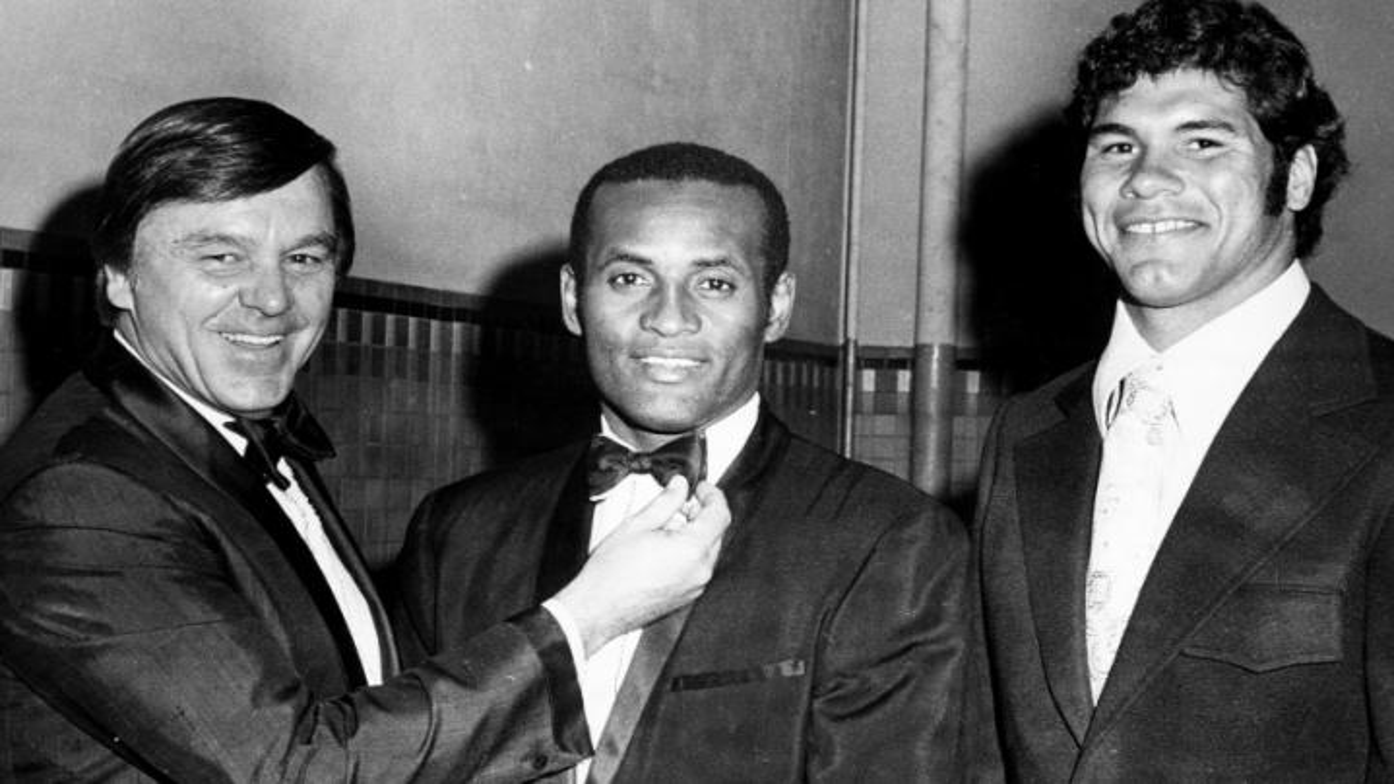Roberto Clemente, center.