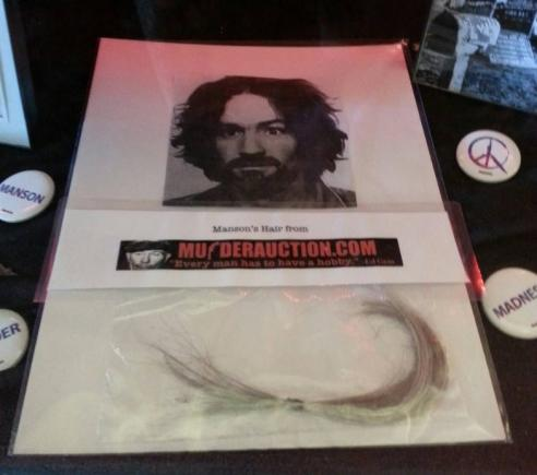 A lock of Charles Manson's hair up for sale on MurderAuction.com.