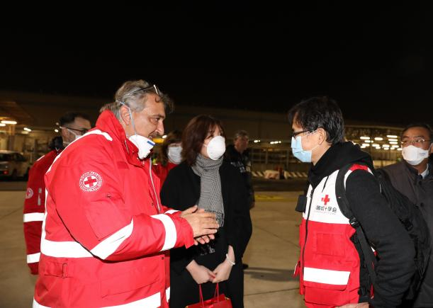 Italian Red Cross Association welcomes the medical team arriving from China to help battle coronavirus spread in Italy.