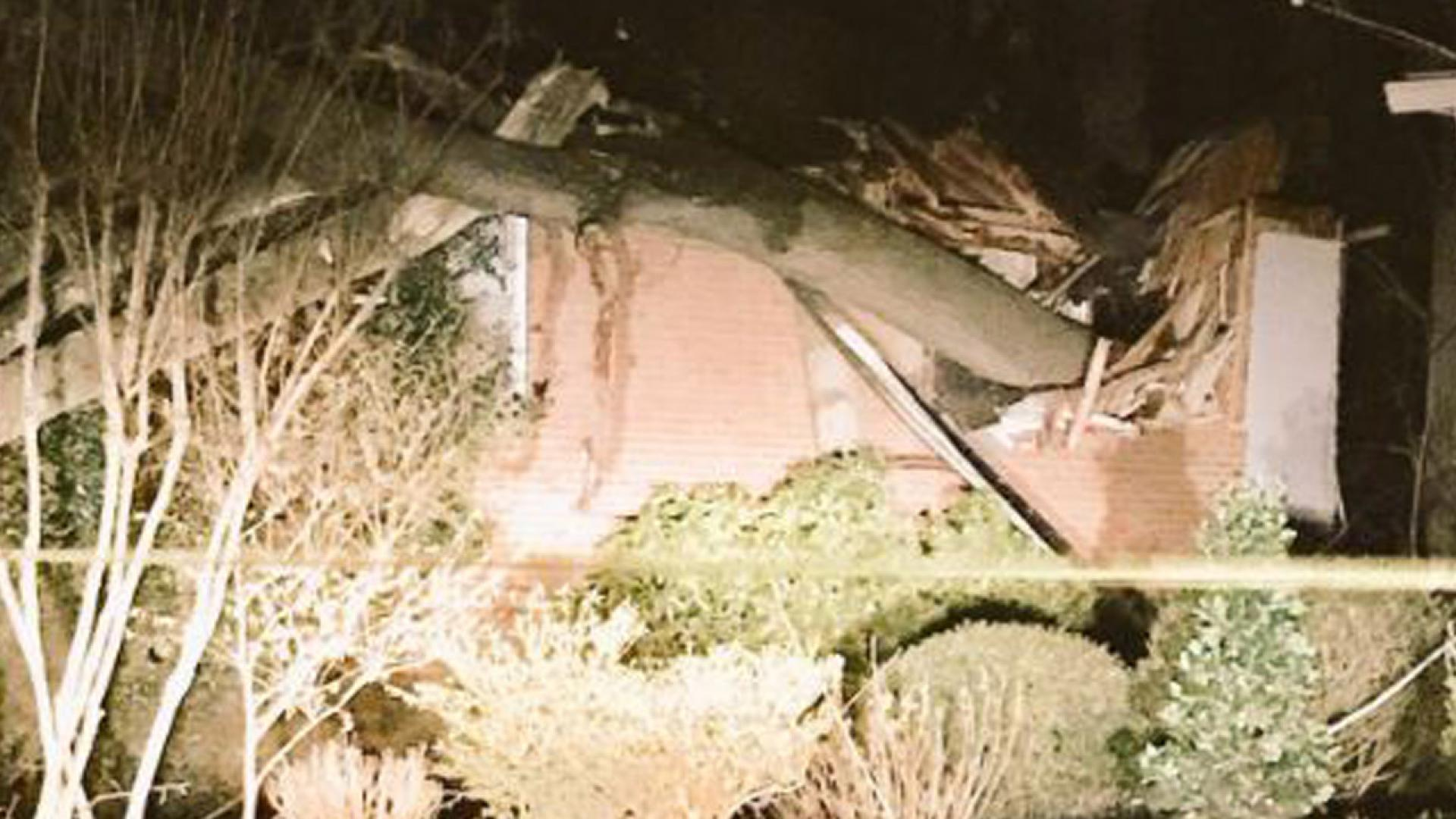 A 100-year-old woman was in her bedroom when a tree came crashing through.