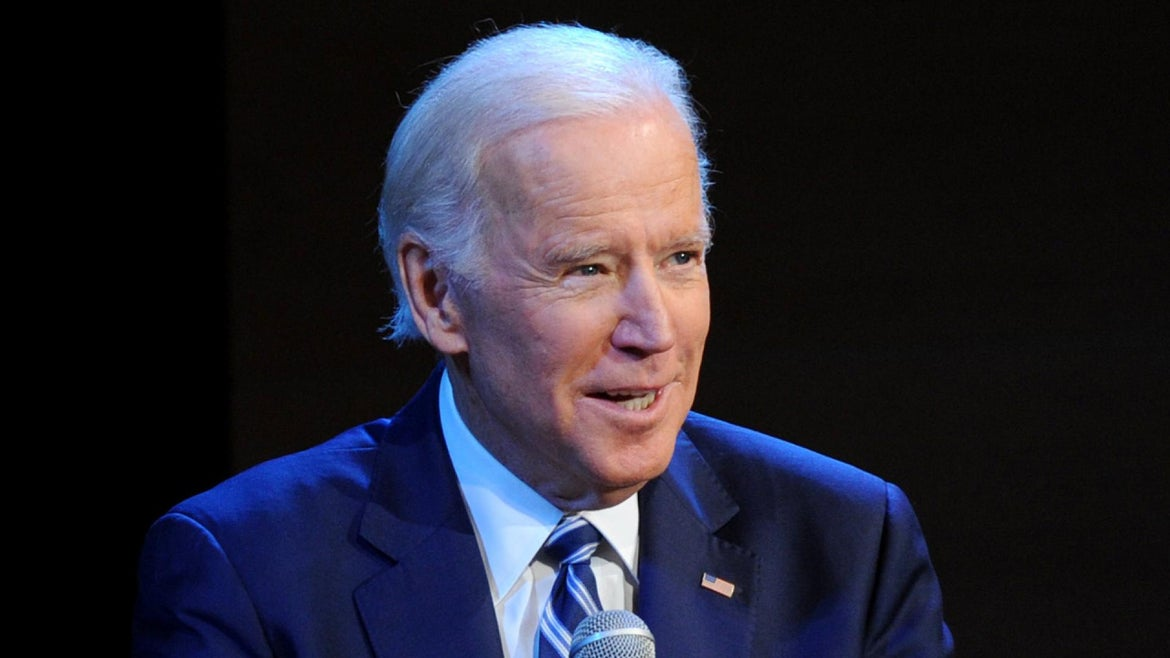 Former Vice President Joe Biden was spotted speaking with a man who appeared to be homeless in a photographed exchange that has since gone viral.