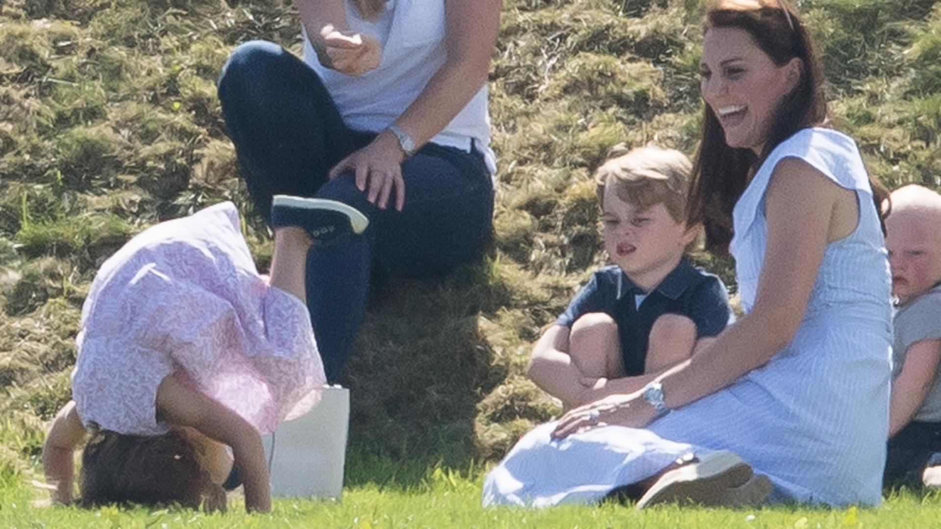 Princess Charlotte, 3, was photographed showing off her acrobatic skills to her mother, Duchess Catherine, and her big brother, Prince George, 4, at Beaufort Polo Club in Gloucestershire.