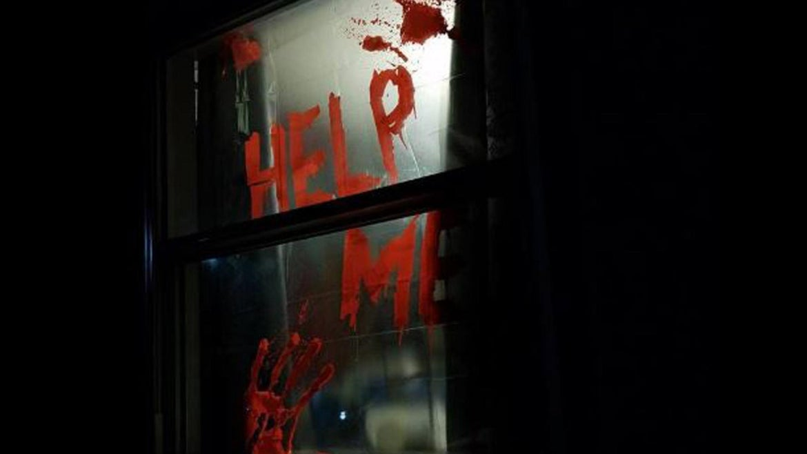 """A creepy window decal spelling out """"Help Me"""" in what looked like blood left a neighbor thoroughly spooked."""
