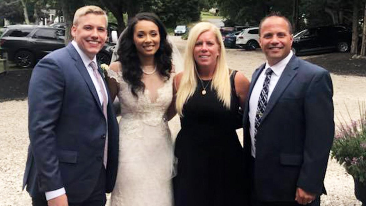 The bride and groom (left) embrace the family of the heart donor (right).