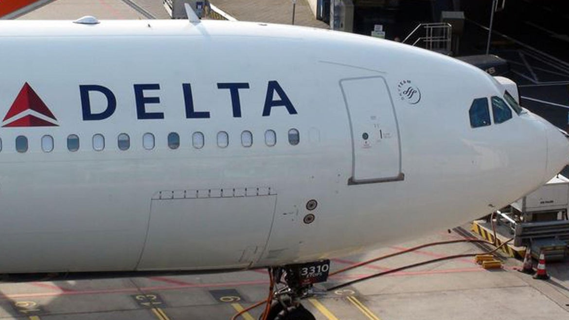 The man says he was forced to sit in dog feces for hours aboard Delta flight.