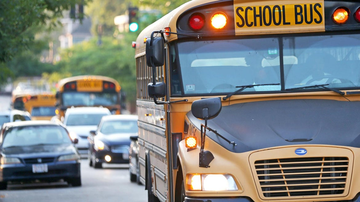 An 11-year-old girl and her friend were approached by a man in a car as they were leaving school.