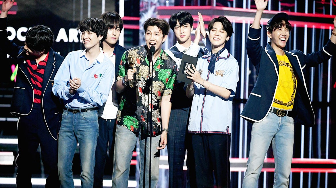 BTS poses on stage at the 2018 Billboard Music Awards.