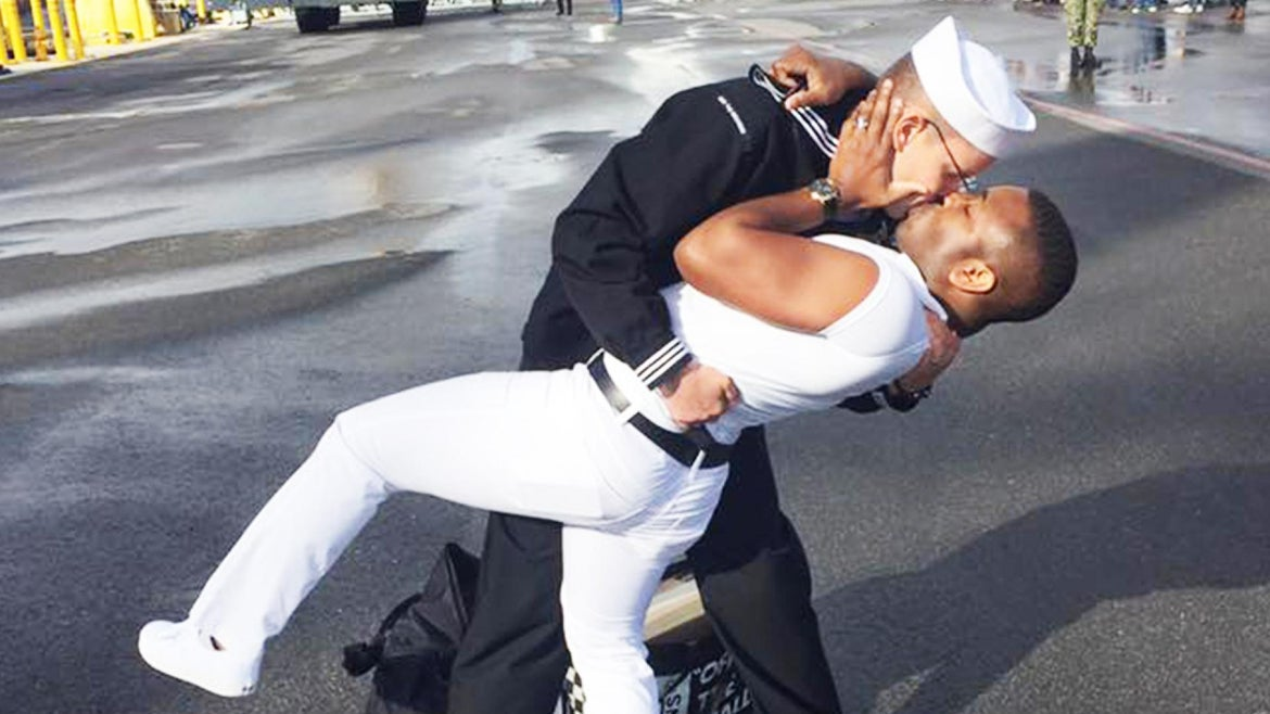 Bryan Woodington, a sailor on the USS The Sullivans, dips his husband Kenneth during their ceremonial first kiss.