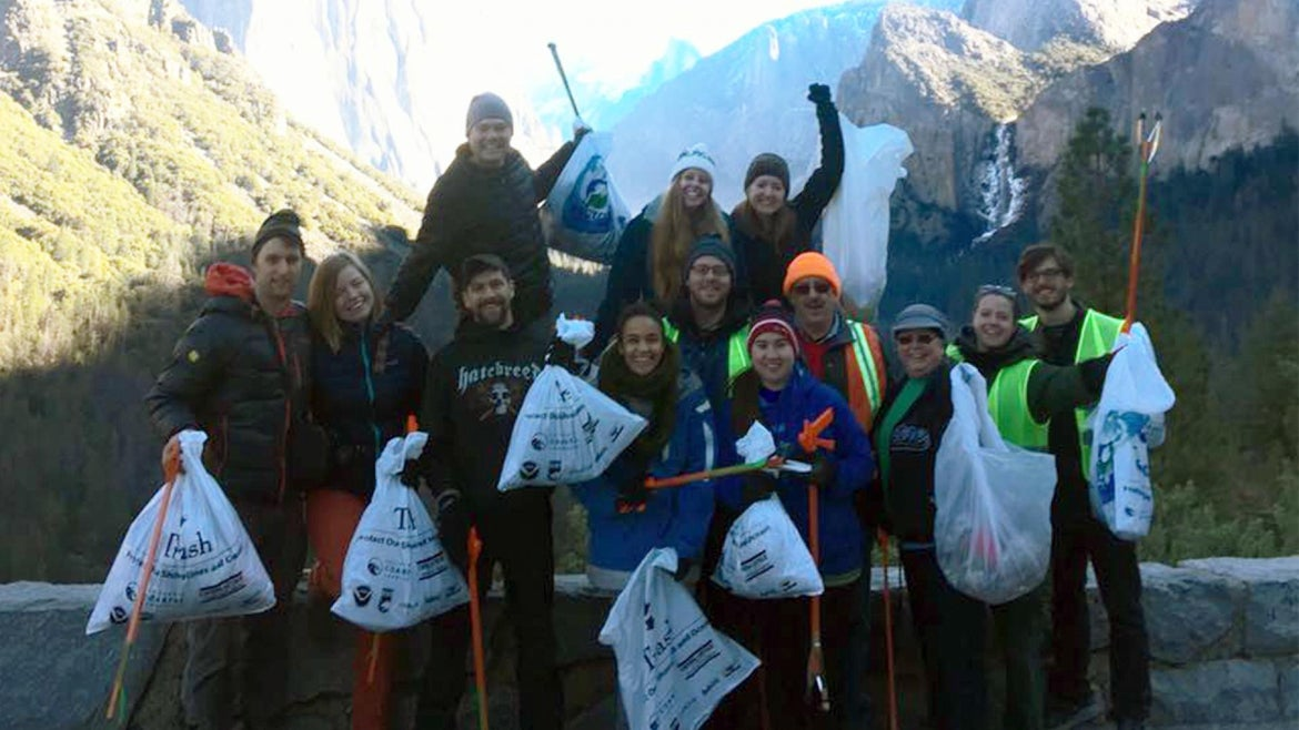 Volunteers with Ken Yager's team pick up trash and other litter in Yosemite National Park.