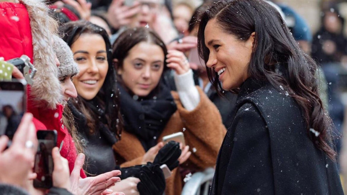 The royal couple were meeting children from the Abbeywood pre-school in the city as snow flurries came down on them.