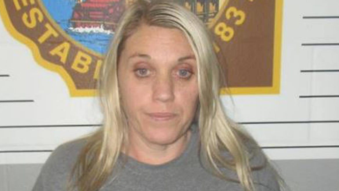 Amy Murray, 40, was arrested Thursday in connection with the death of her husband, Joshua Murray, whose body was discovered inside their burning Iberia home in December, the Miller County Sheriff's office said.