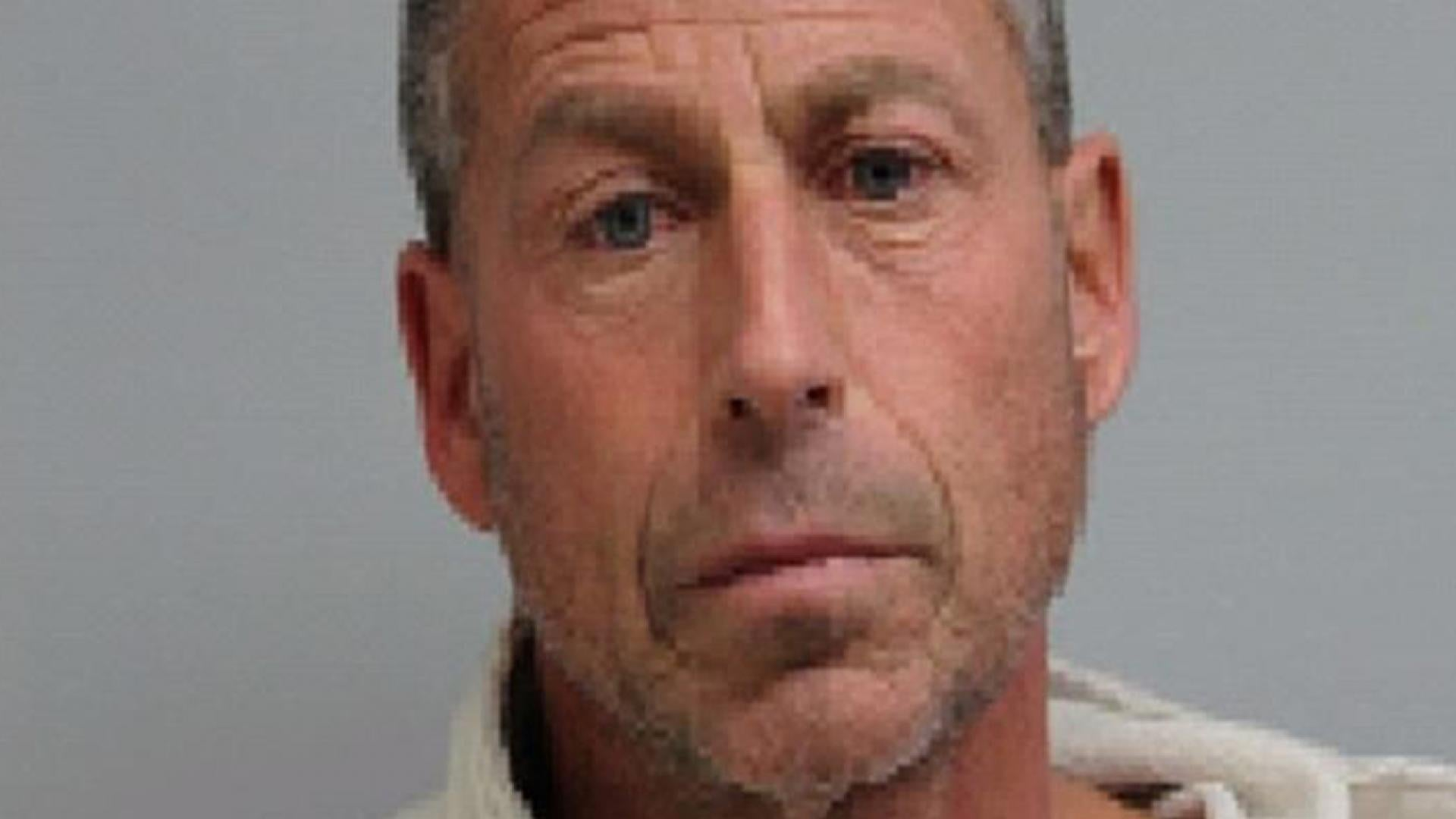 Erick Huska allegedly closed the lid of his hot tub on his wife.