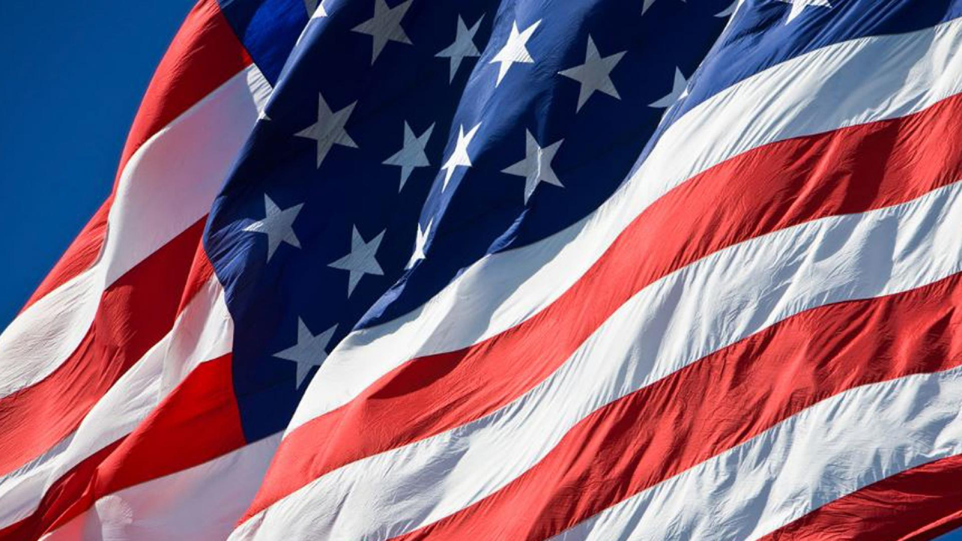 The boy argued with a teacher over standing for the Pledge of Allegiance, police said.