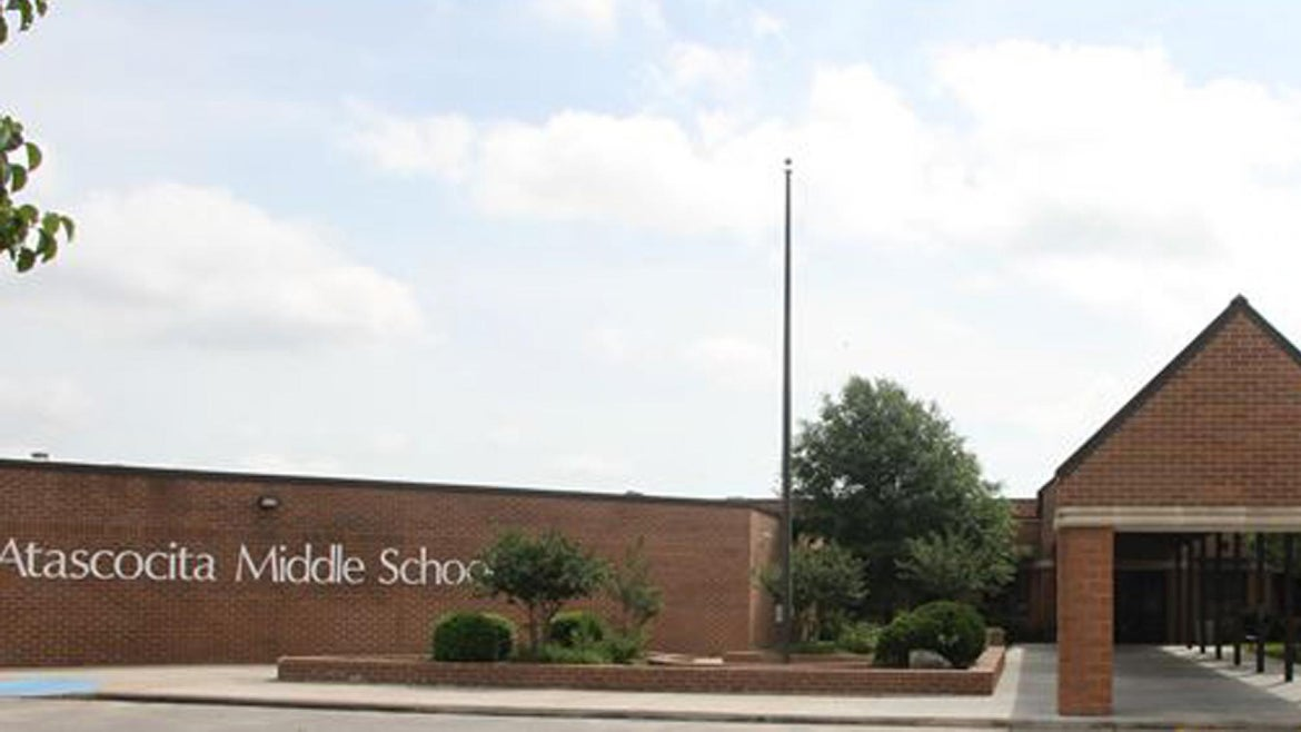 A middle school student brought a blade and a hit list on campus, authorities said.