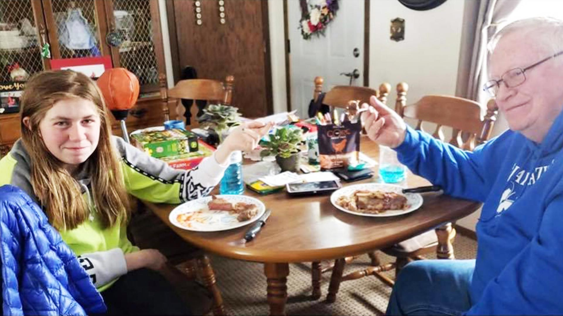 Jayme Closs grins while enjoying a steak lunch with her grandfather.
