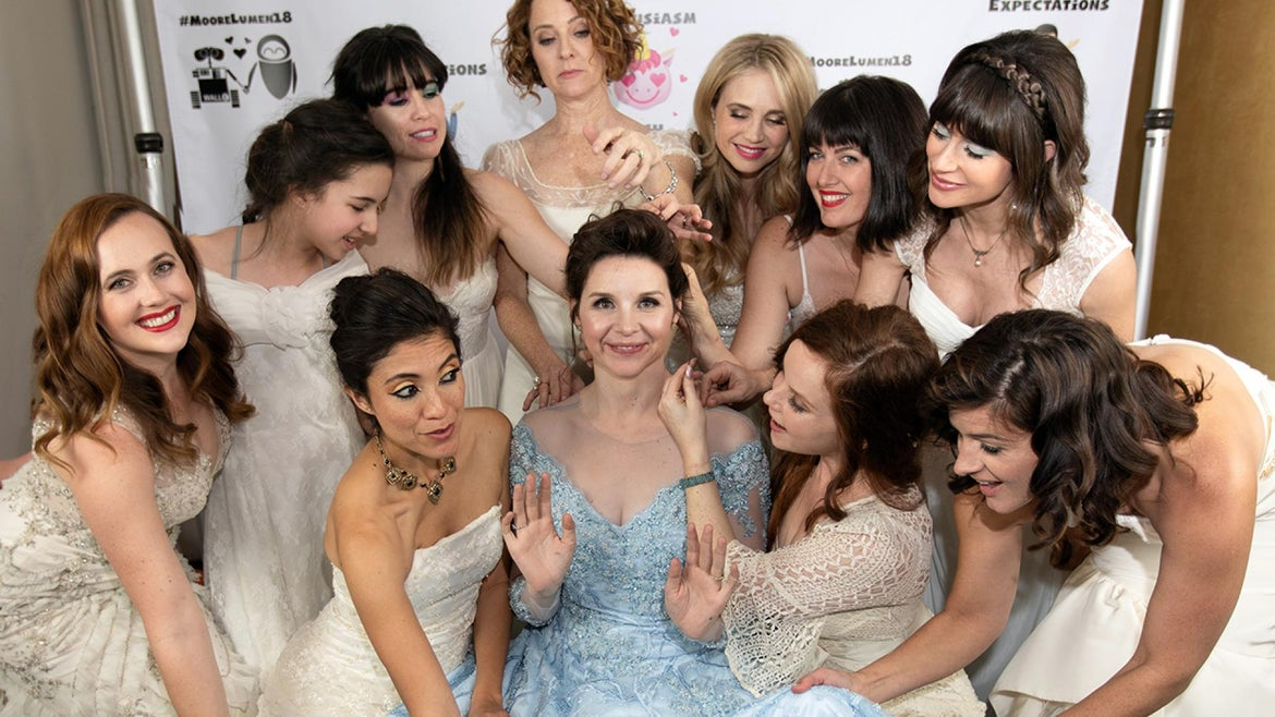 Audrey Moore (center) is surrounded by all the other brides on her wedding.
