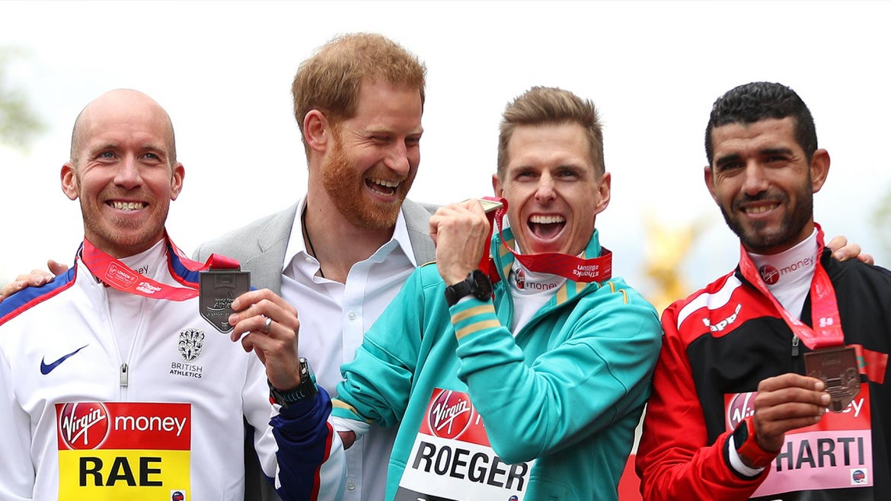 Prince Harry cheered on runners at the London Marathon Sunday.