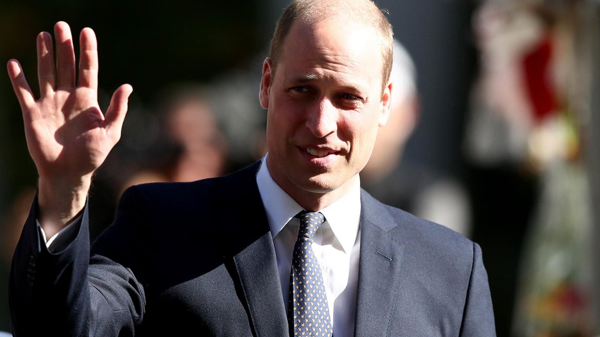 Prince William gives a wave while out and about.